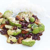Cauliflower braised with azuki beans, cashew nuts, and garlic,