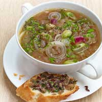 Three onion soup with cheese and bean crostini,