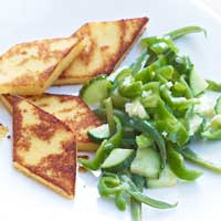 Gruyère and polenta slices with green vegetable salad,