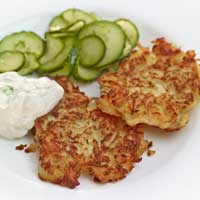 Potato and sauerkraut rösti with scallion quark and cucumber and dill salad,