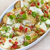 Raclette baked potatoes with tomato and mixed pickle salsa,