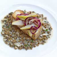 Smoked tofu with mustard, onions, and pears on creamed lentils,