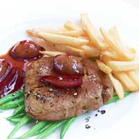 Seitan steak with green beans, red wine shallots, and French fries,