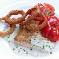 Tofu steak with Dijon mustard sauce, grilled tomato, and baked onions,