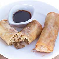 Crispy spring rolls stuffed with cabbage and oyster mushrooms,