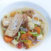 Lentil stew with winter vegetables and smoked tofu,