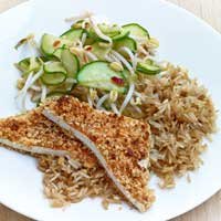 Tofu and peanut schnitzels with chile and cucumber bean sprout salad and brown rice,