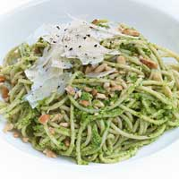 Whole grain spaghetti with pesto and pine nuts,