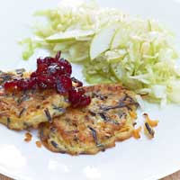 Wild rice and carrot fritters with pear and cabbage salad and cranberries,