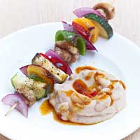 Grilled vegetable skewers with bean cream and lime-chili oil,
